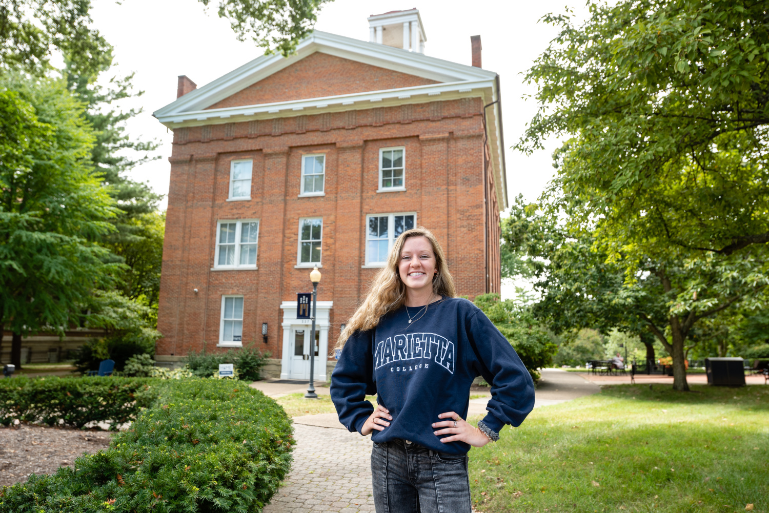 A Marietta College student poses in front of Erwin Tower