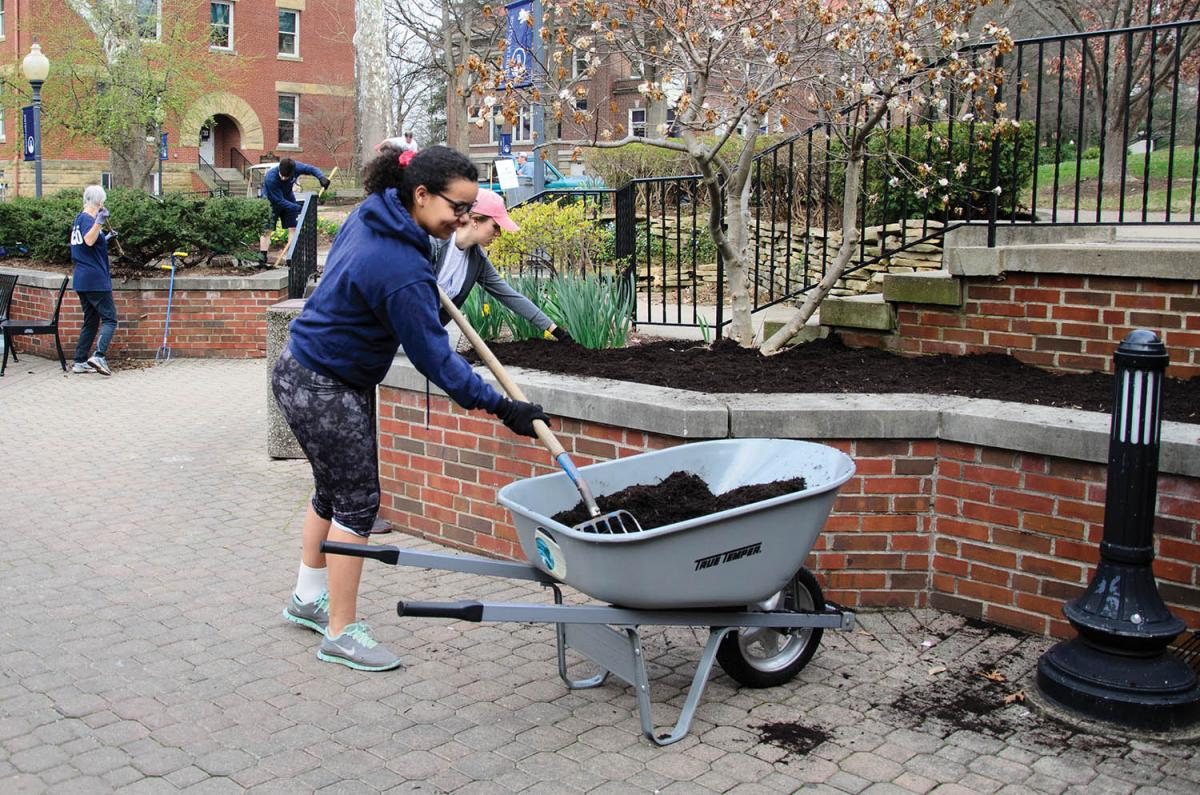 Dozens of students and employees gathered on The Christy Mall this spring to do landscaping and other work as part of Green Up Day.
