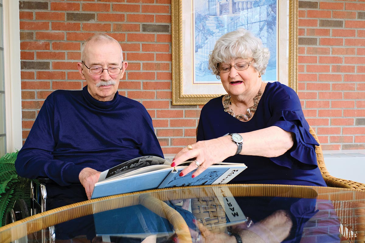 Carl and Judy Heinrichs look at a Marietta College yearbook together