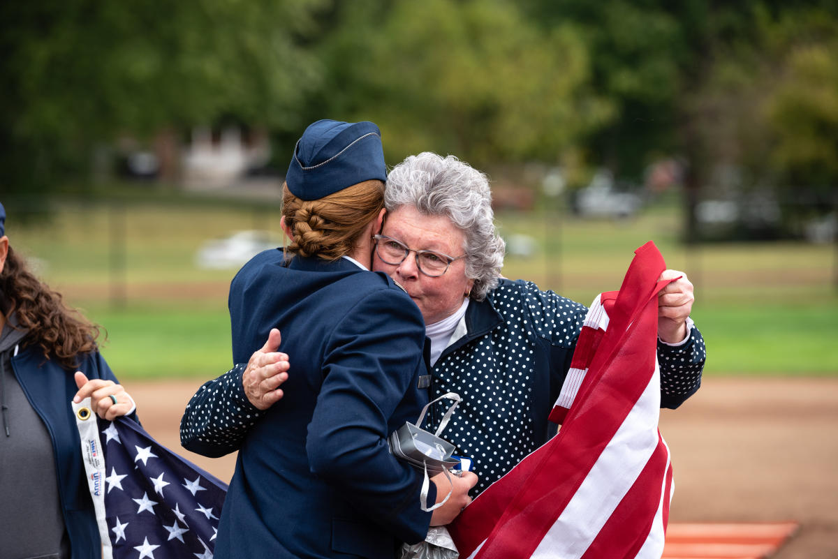 Brittany Curry '15 hugs Jeanne Arbuckle after her promotion ceremony on the Marietta Softball Field