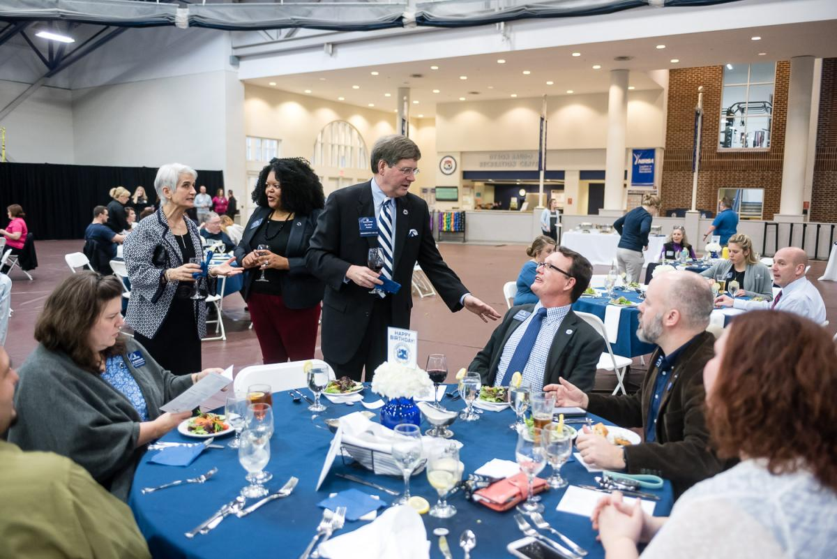 President Ruud Talks with fellow employees at the 2018 Marietta College Founders Day