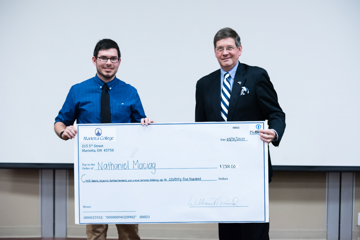 "President Ruud presented Nathaniel Maciag '19 with a check for $7,500 for his project ""Slice of Life Bakery."""