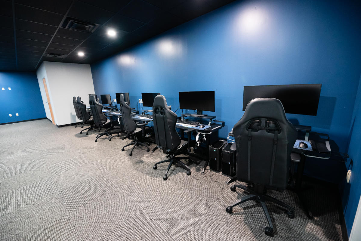 eSports Room with Gaming PCs, Desks, and Chairs