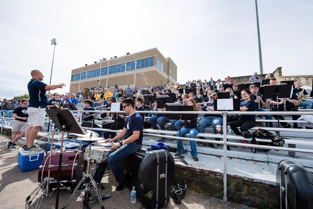 The Marietta Pep Band plays at a football game in Don Drumm Stadium