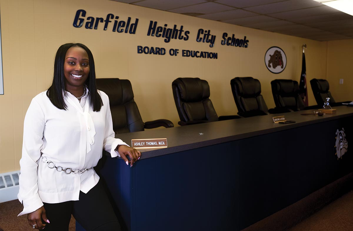 Ashley Thomas poses in front of the Garfield Heights City Schools Board of Education Sign