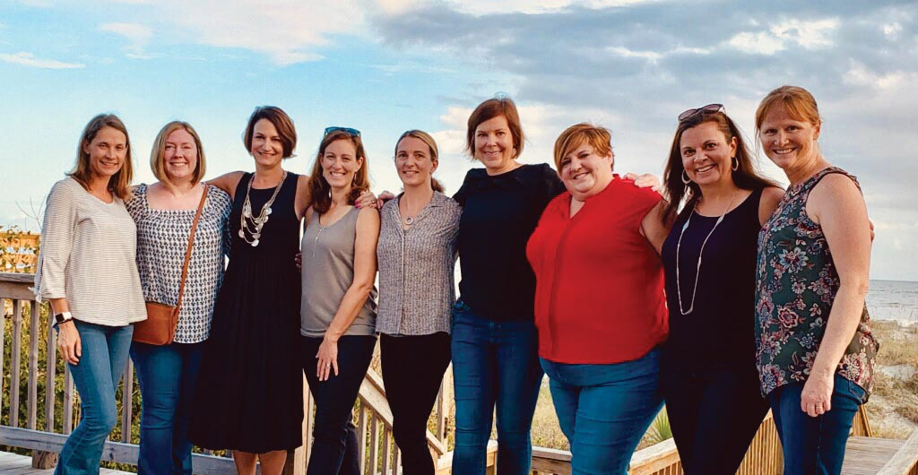 A group photo of 9 Marietta College Alumnae at the beach