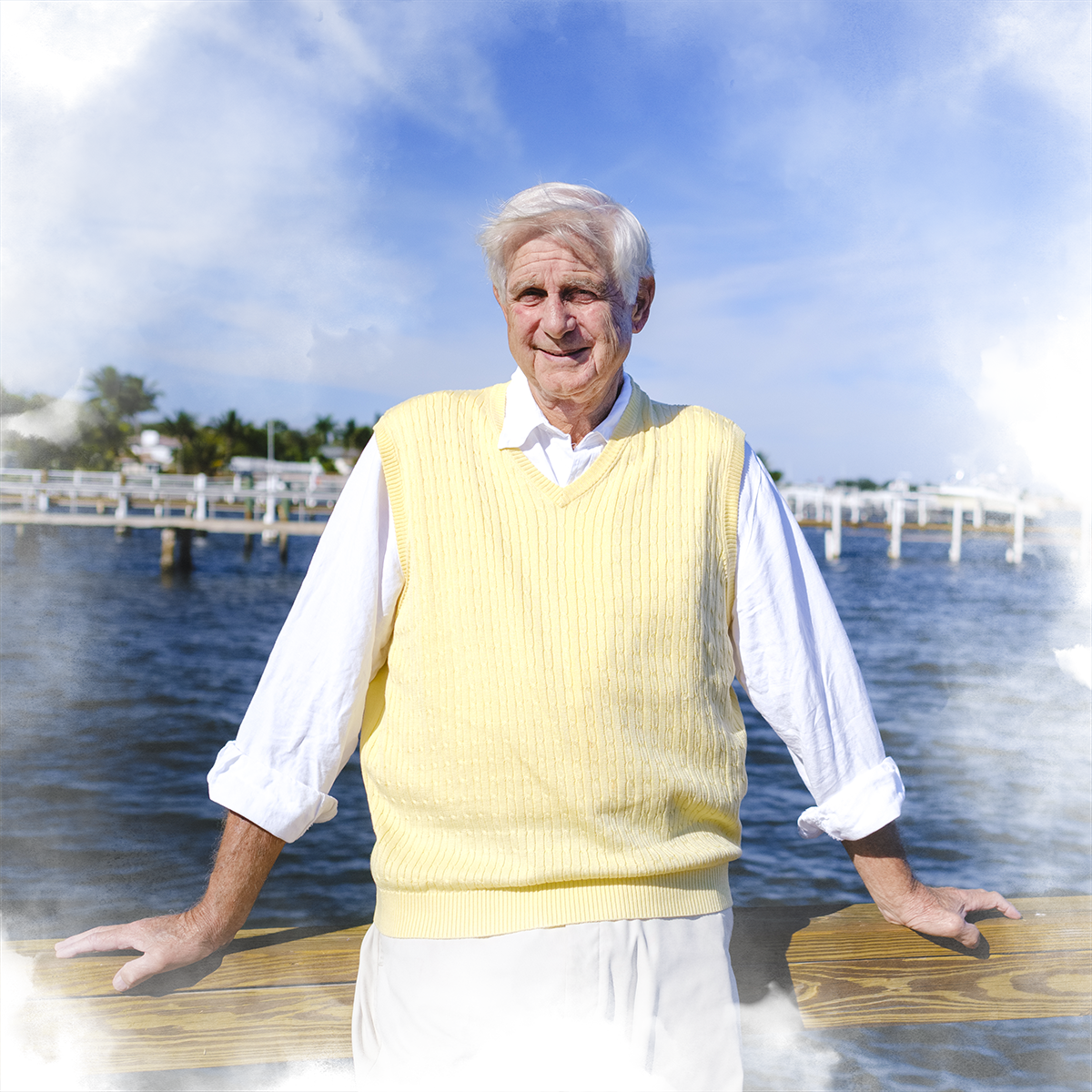 James Byer '66 poses on a boat dock