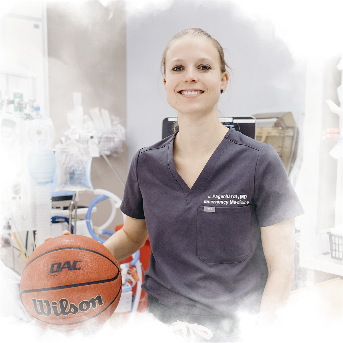Justine Pagenhardt '08 poses with a basketball in the emergency room where she works