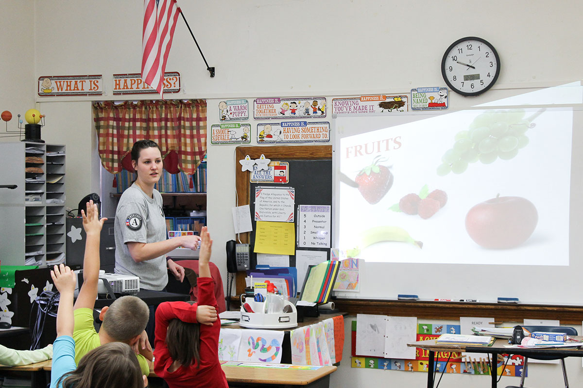 A Marietta College Student teaching kids as part of the Live Healthy Kids Volunteer Program