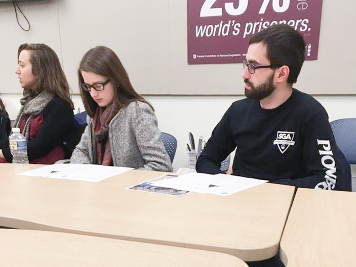 Marietta College students sit at a table for a self learning program through the Office of Civic Engagement