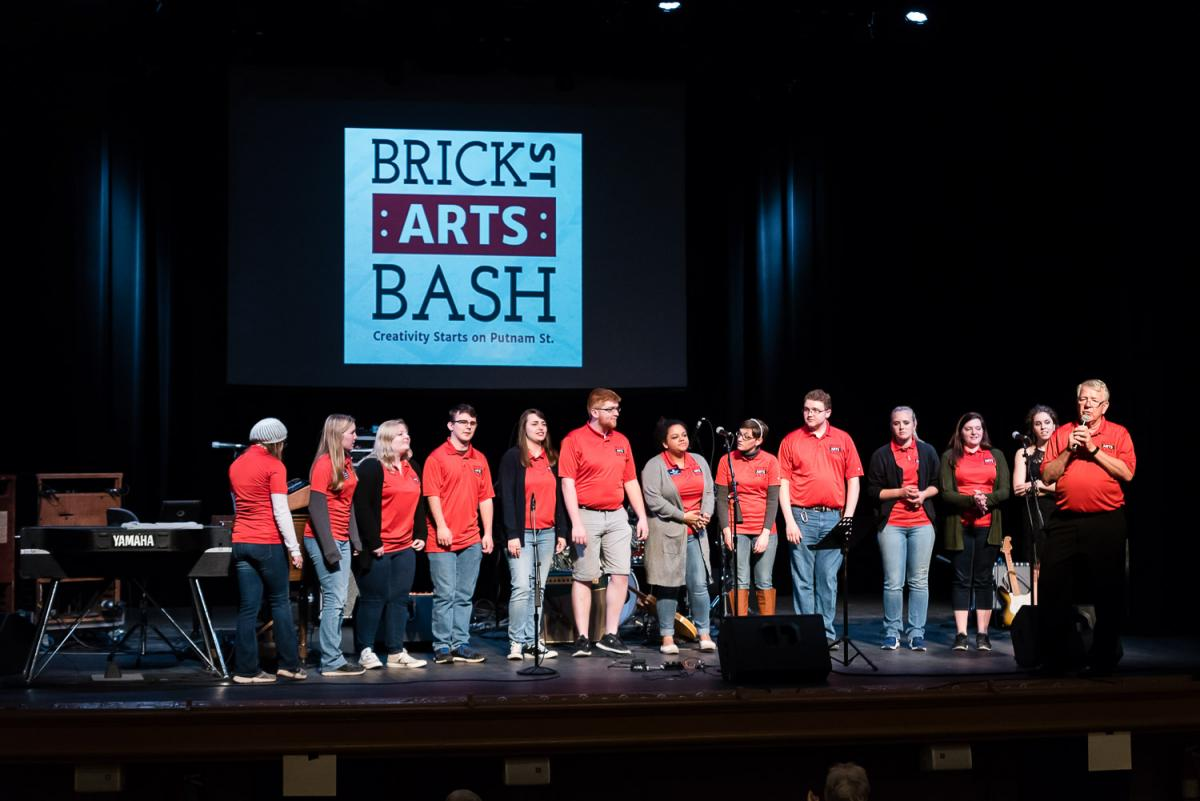 Marshall Kimball (far right) recognized the Brick Street Arts Bash planning committee, made up of Marietta College students, for their months of work leading up to the event