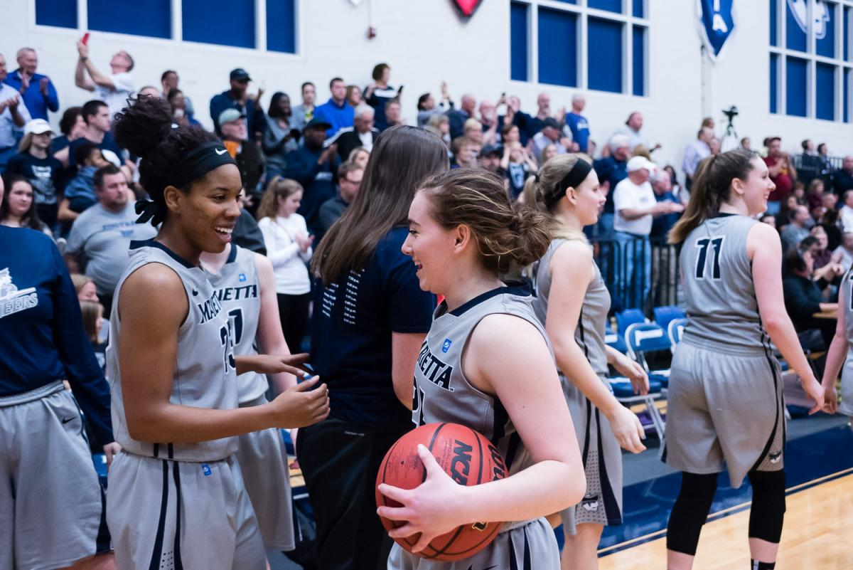 Womens Basketball Players celebrate after a win