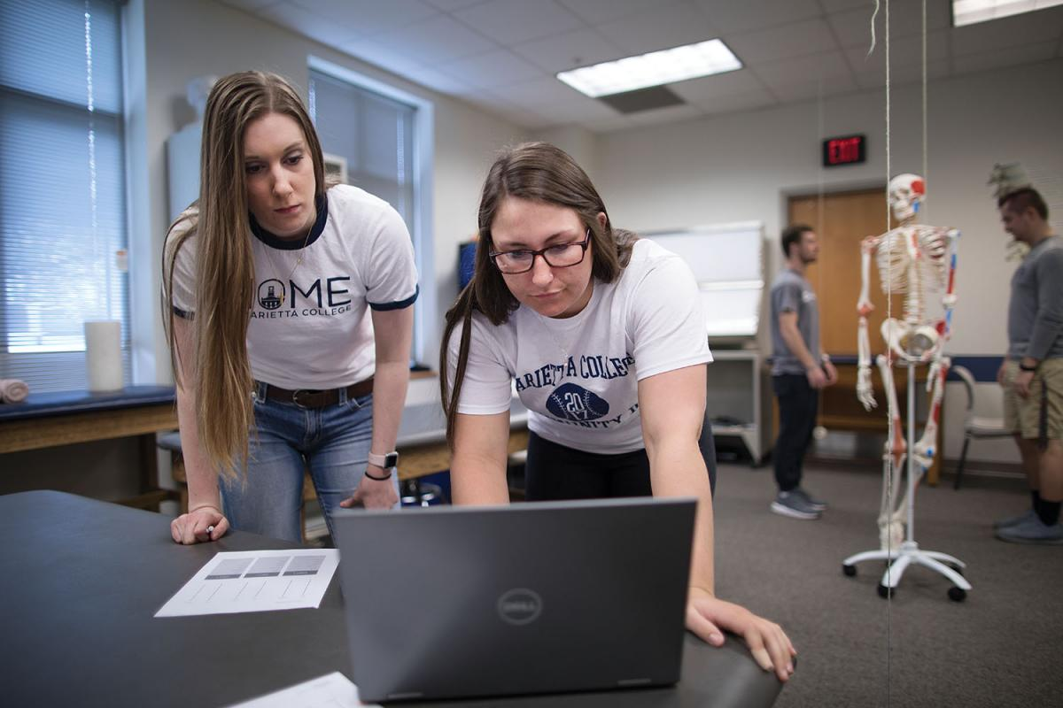 Erin Miller '20 (right) and Alexis Enochs '20 work on a project during Associate Professor Jaclyn Schwieterman's Biomechanics class.