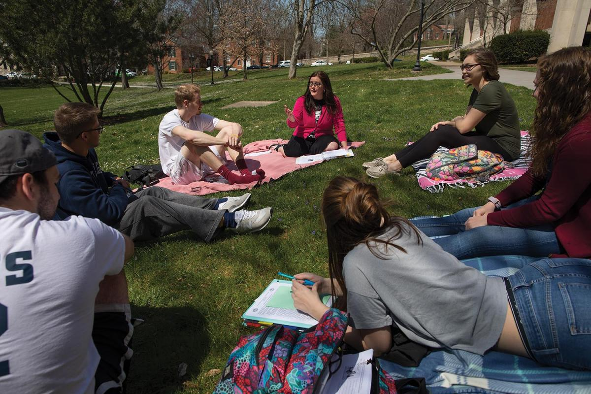Instructor Ann Kaufman found the perfect place to conduct her Education class earlier this spring - on the lawn in front of Erwin Hall