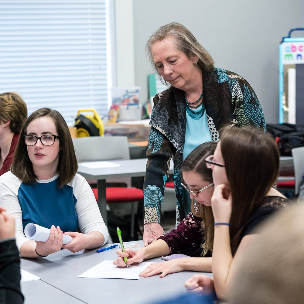 Dottie Herb of Marietta College listens to students in the classroom