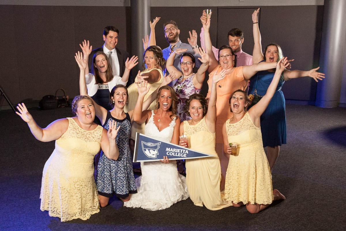 Tasha Faulkner '07 and Eric Strome were married on Aug. 19, 2017, at Churchill Downs in Louisville, Kentucky. The bride was joined by fellow Marietta College alumni, including (from back left to front right) Neil Thompson '05, Sean McManus '04, Daniel Michalak '07, Melissa Jones Thompson '05, Holly Bader Probst '06, Jenn DeGain McManus '06, Carrie Corder Bell '07, Jasmine Goodnight '07, Erin Carlin '08, Ashlyn Heider '06, Tasha, Amy Latorre Chubak '06 and Jessie Harris '07.