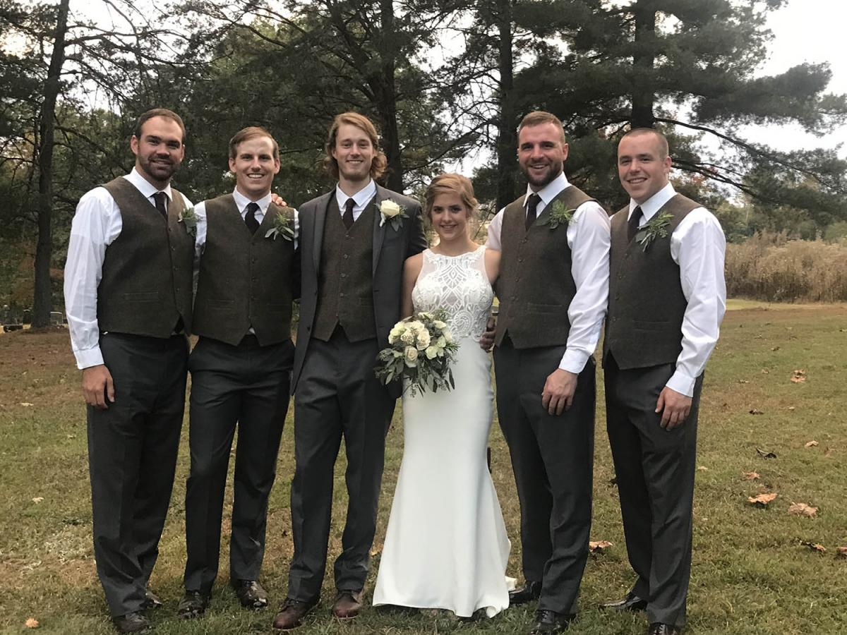Joseph Unger '14 and Sunni Clyse were married on Oct. 7, 2017, at Saint Lawrence Catholic Church in Ironton, Ohio. Pictured with the couple are groomsmen (from left) Taylor Pottmeyer '14, Jonathan Monnig '14, Joseph, Sunni, Eric Hansen '14 and Lucas Eick '14. Other alumni in attendance were Payton Blair '15, Darci Combs '14, Kaitlin Pottmeyer '16, Andrew Fitzgerald '14, Tim Hemenway '14, Stacey Smith '14, Melina Feitl '14, Megan Heater '16 and Layne Archer '16. The newlyweds spent three weeks in Australia and are residing in Columbus, Ohio.