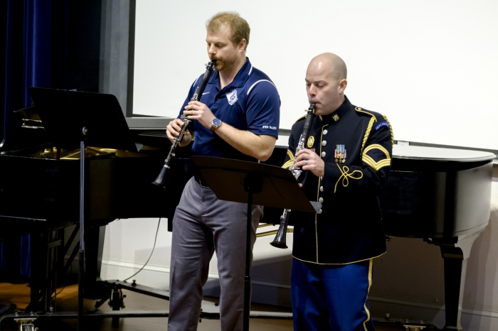 Two men playing clarinets