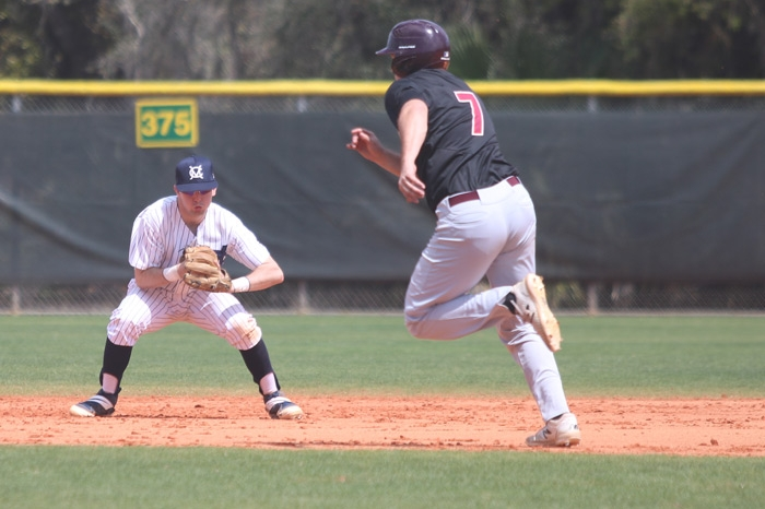 Infielder tries to field a ground ball