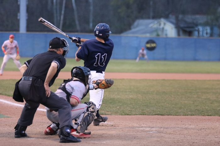 Baseball player following through on a swing