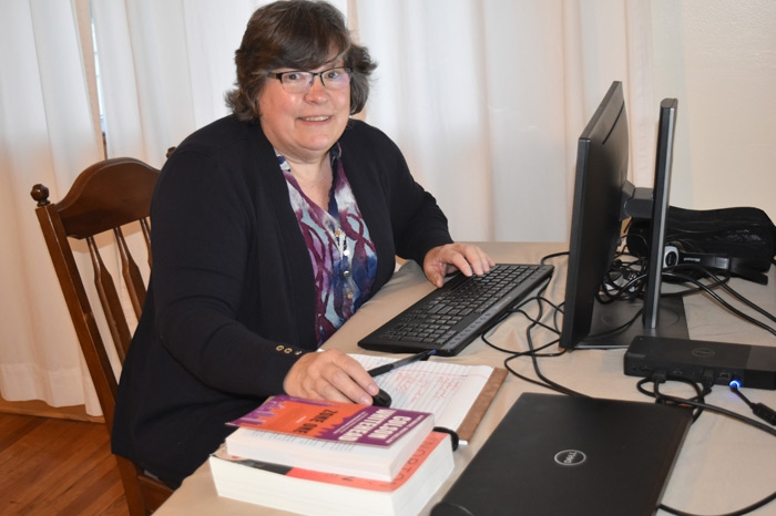 Professor Bev Hogue teaching class remotely from her home
