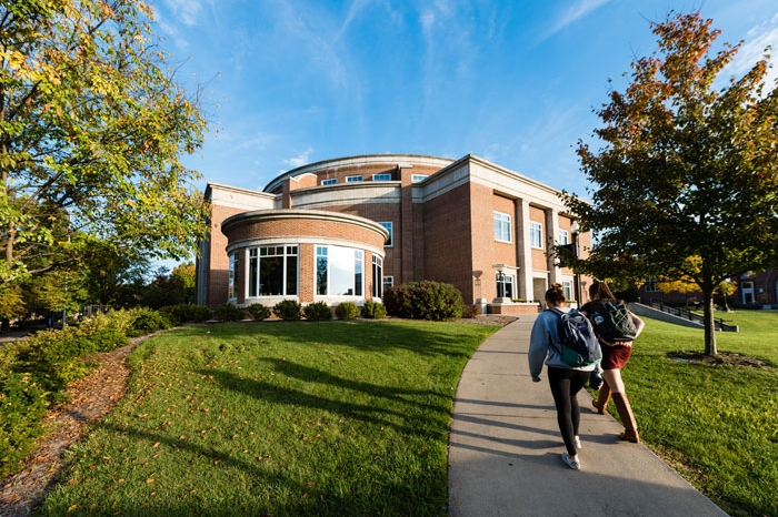 Two students walking toward Legacy Library