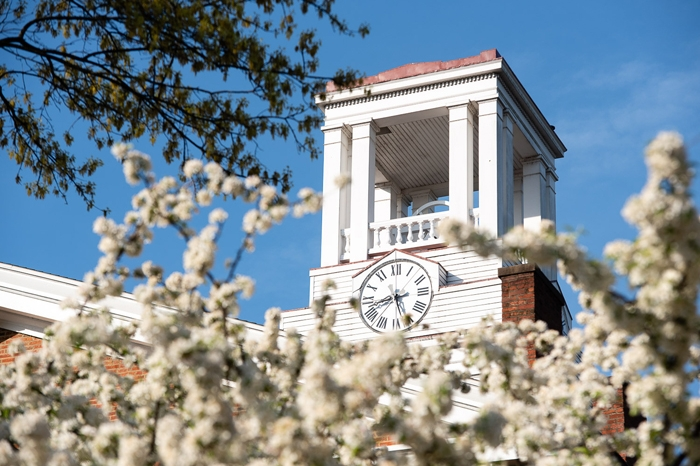 Erwin Tower behind flowers on the campus of Marietta College