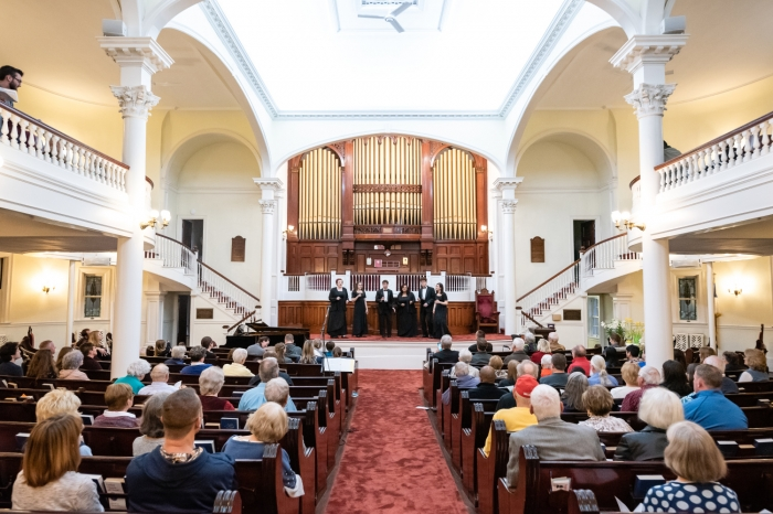 Long view inside First Congregational Church with the choir performing