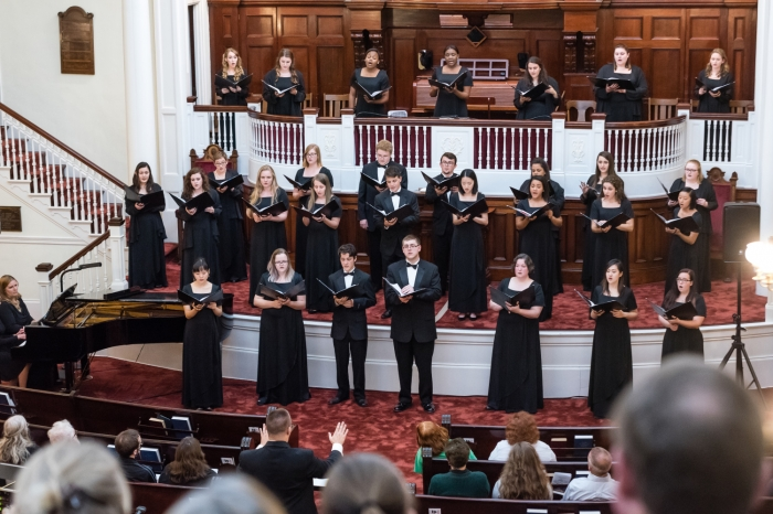 Choir members singing in a church