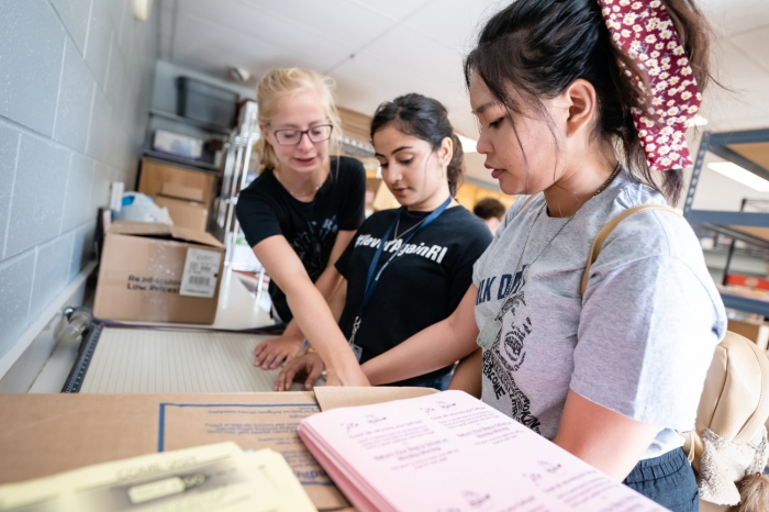 Female students sorting books