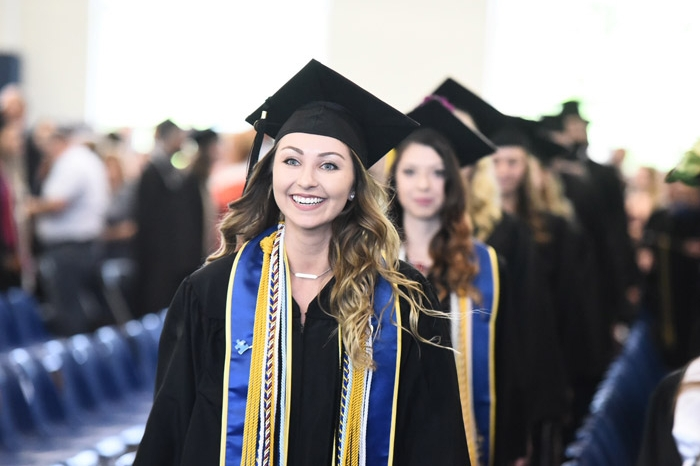 female student entering commencement
