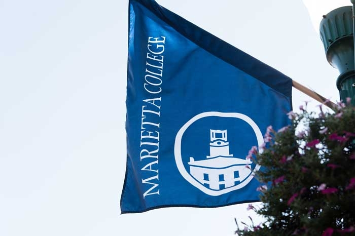 Marietta College flag flying downtown