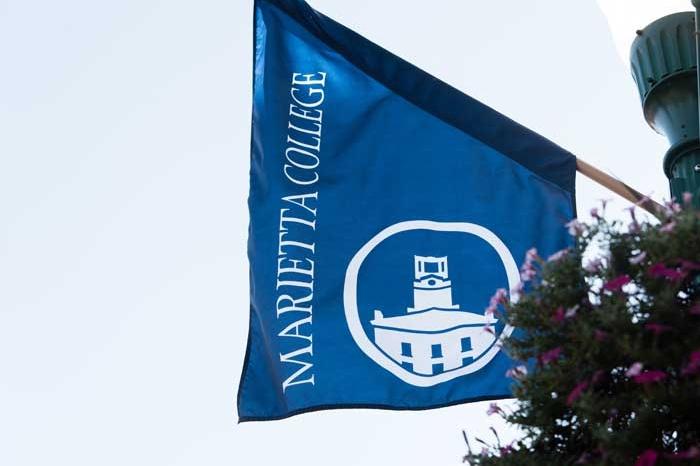Marietta College flag flying downtown