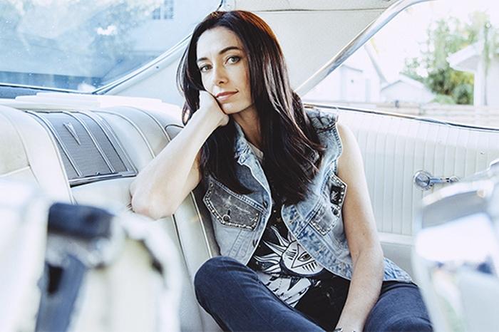 Kara Grainger sitting in the back of a car
