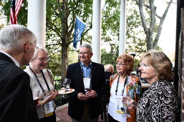 Members of the Class of 1967 gather at homecoming