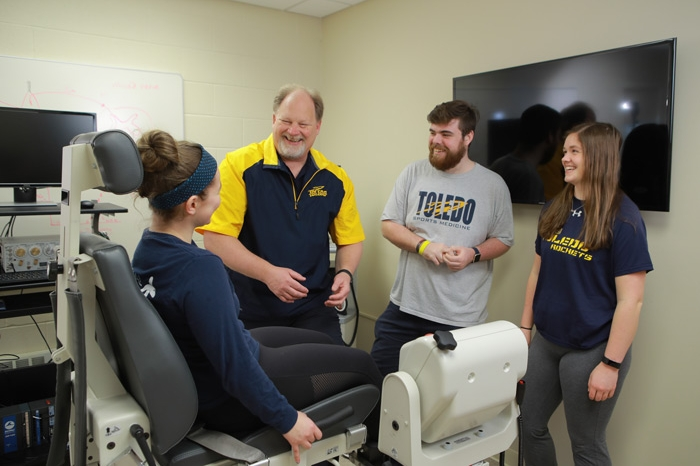 Dr. Chris Ingersoll '85 with students at the University of Toledo