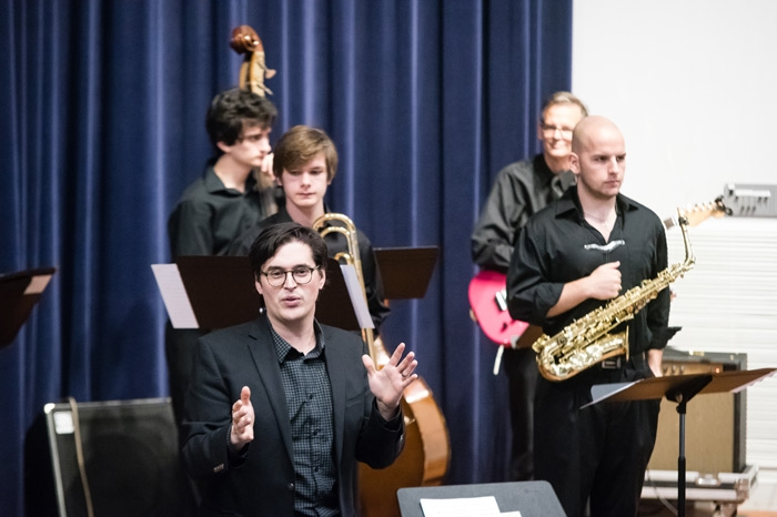 Instructor Jordan Reed leading the Jazz Combo during a concert
