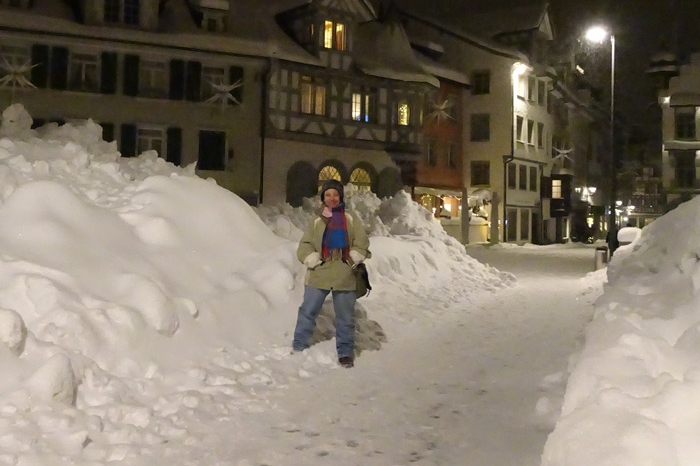 Grace Johnson standing in the snow in Switzerland