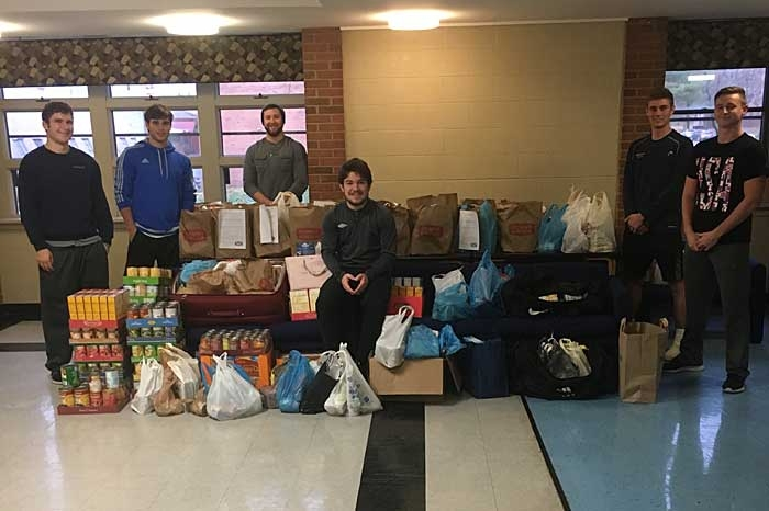 Members of Lambda Chi Alpha with donated food items