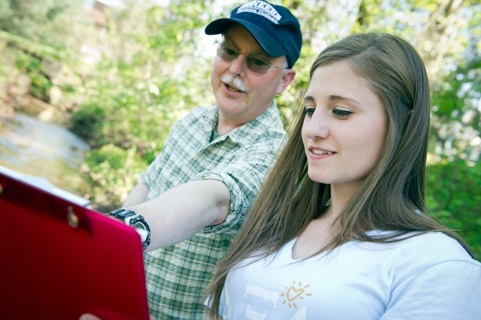 Dave McShaffrey working with a student in the field