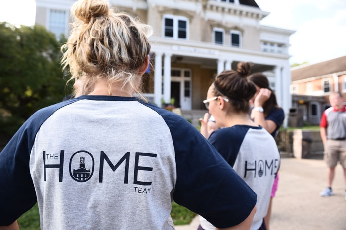 Students wearing HOME T-shirts