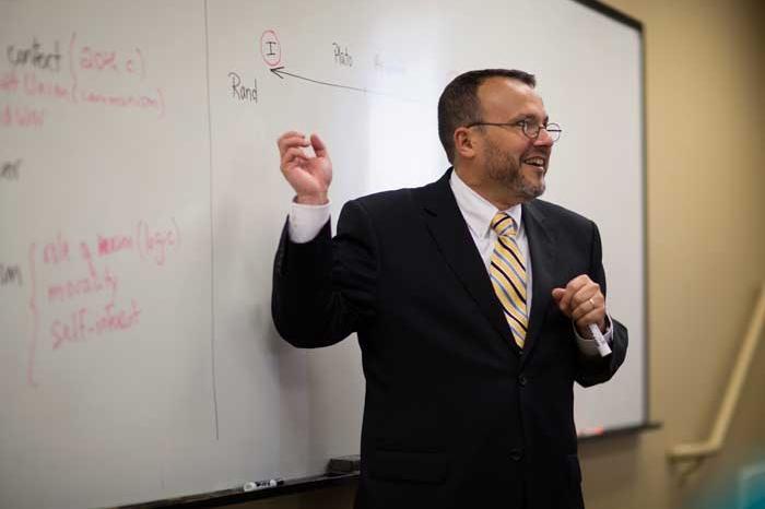 Gama Perruci teaching at white board