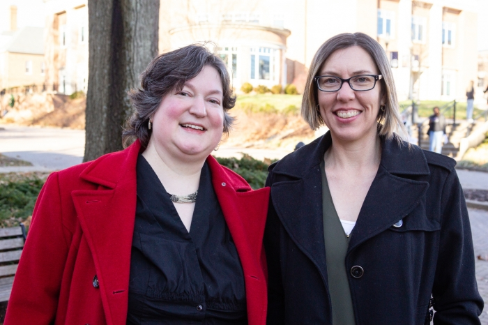 McCoy Professors Lynn Bostrom and Nicole Livengood outside of Andrews Hall