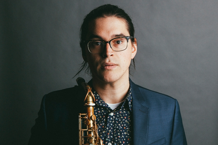 Jordan Reed holding a saxophone