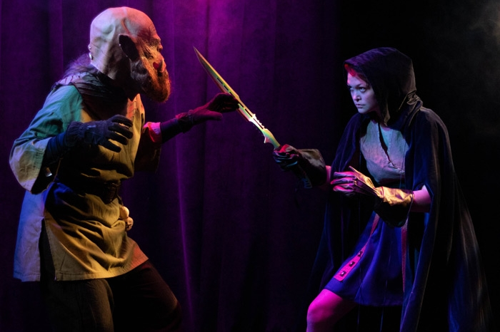 Actress fighting a monster in a play