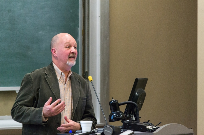 Mark Sibicky lecturing at a podium