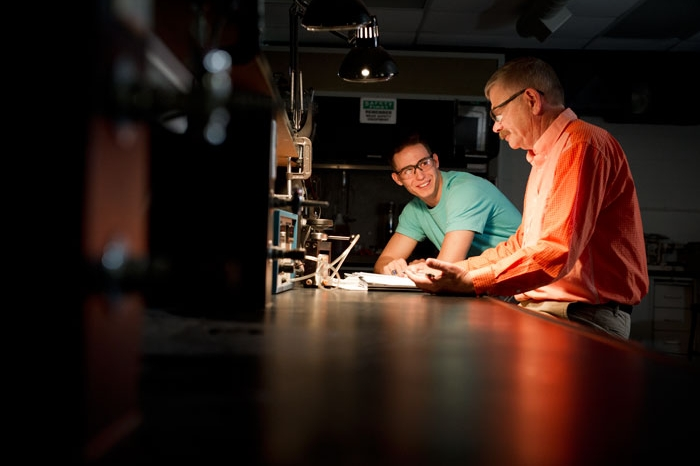 Professor and student working together in a lab