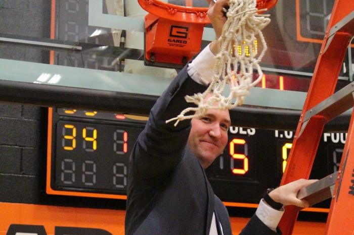 Kole Vivian cutting down OAC nets