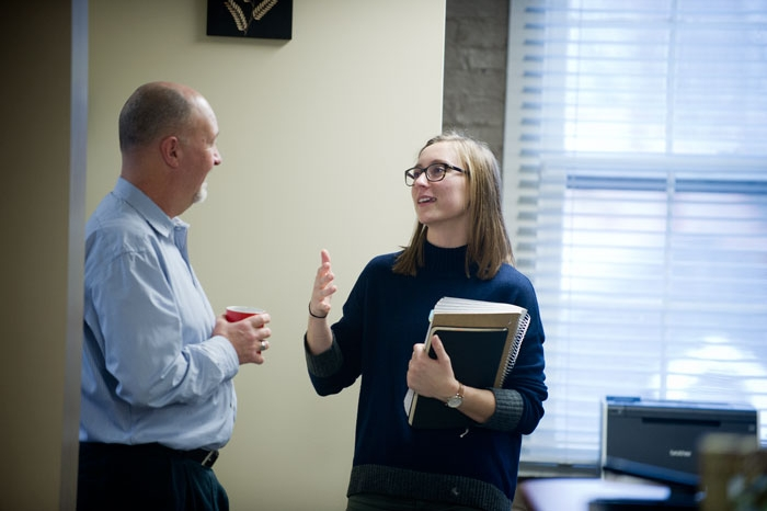Professor Mark Sibicky speaking with a student