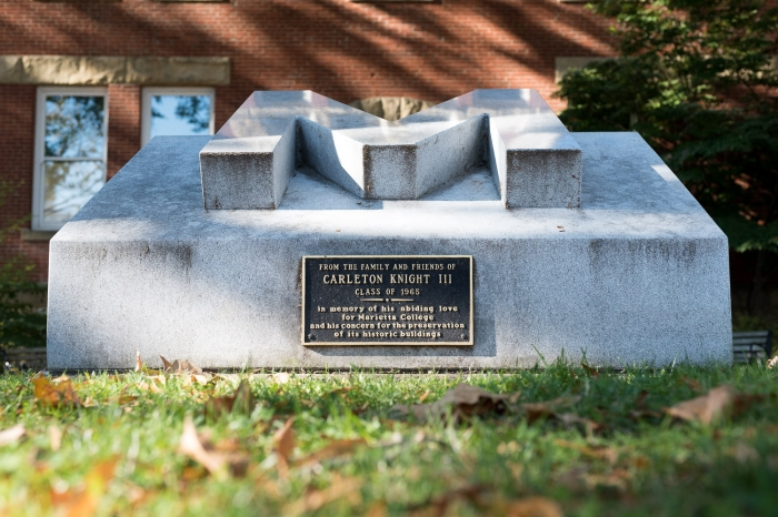 Concrete 'M' memorial outside of Andrews Hall
